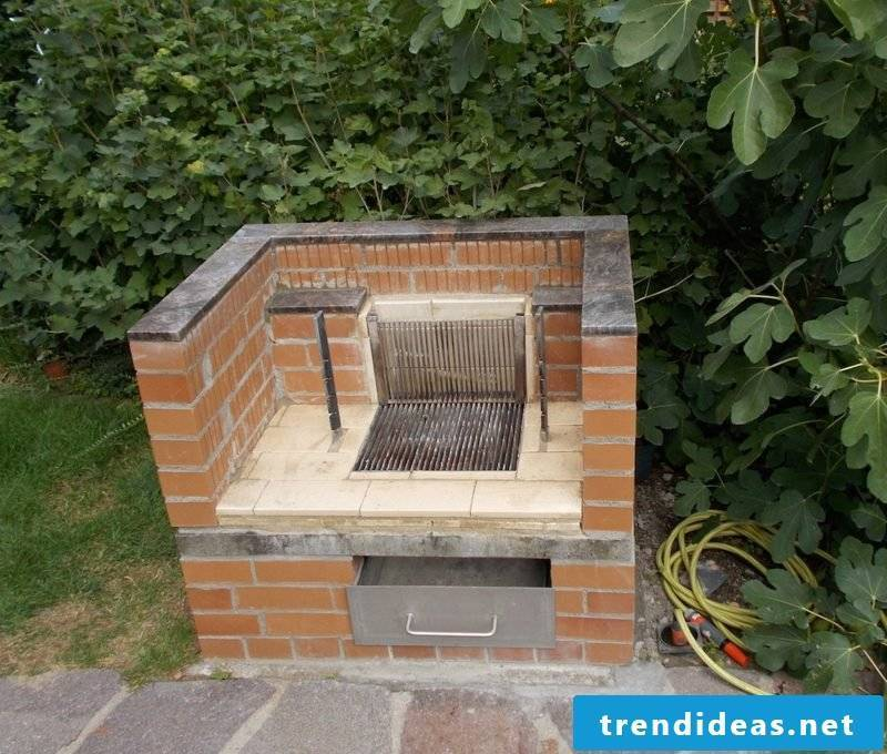 Stone barbecue in the garden of firebricks