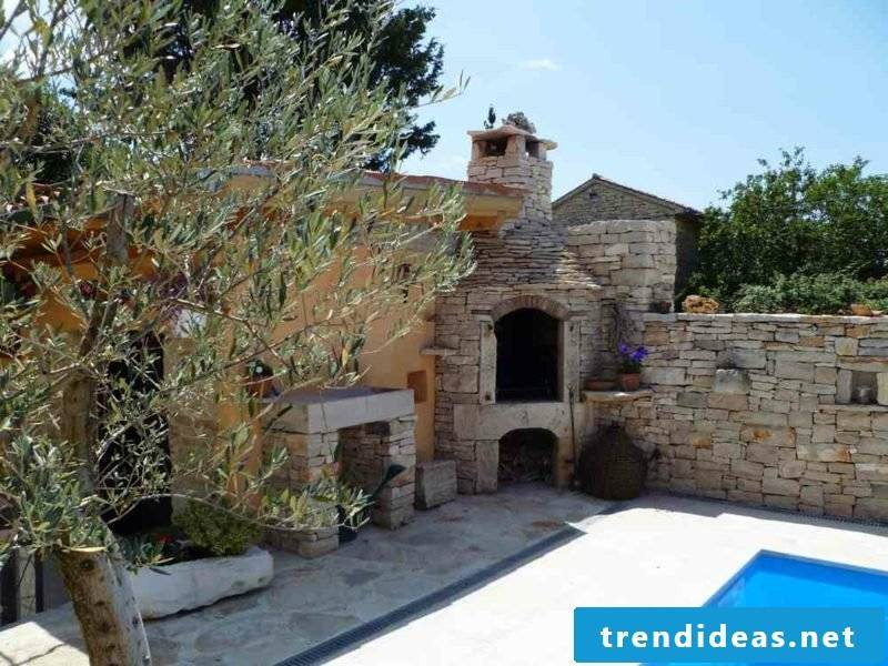 large outdoor fireplace made of natural stone garden