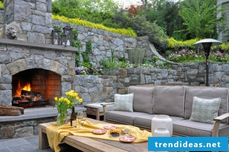Outdoor fireplace made of natural stone terrace
