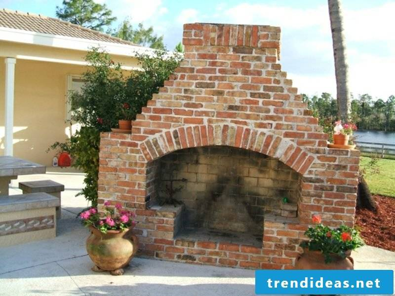 Barbecue fireplace in the garden of firebrick