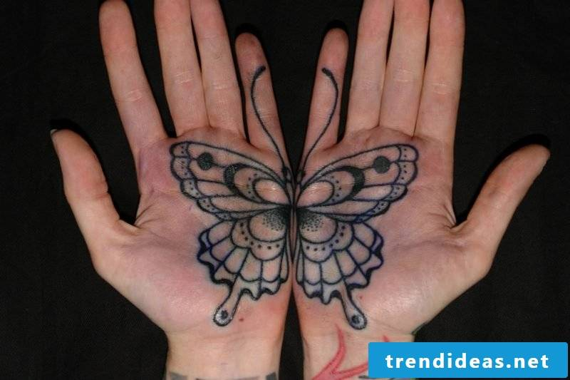 Butterfly meaning Two palm tattoos