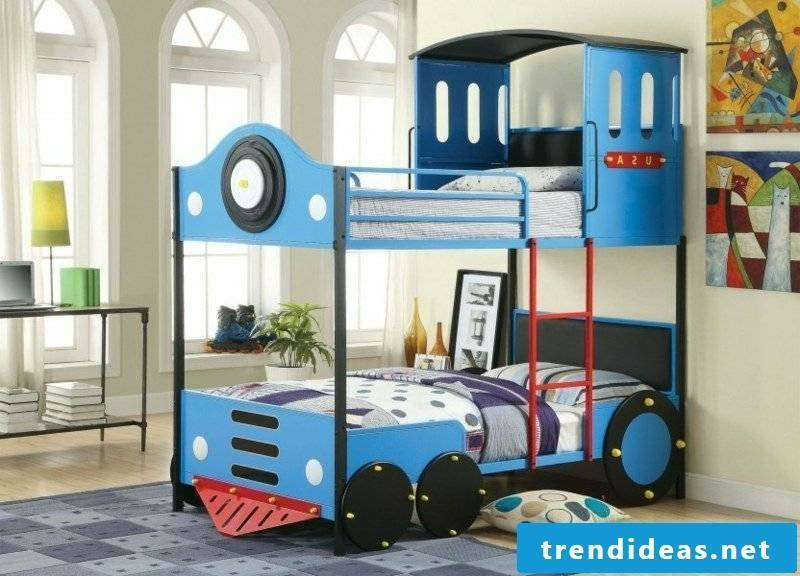 Boys room with growing cot train