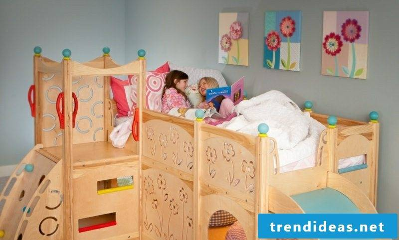 growing cot made of wood with slide