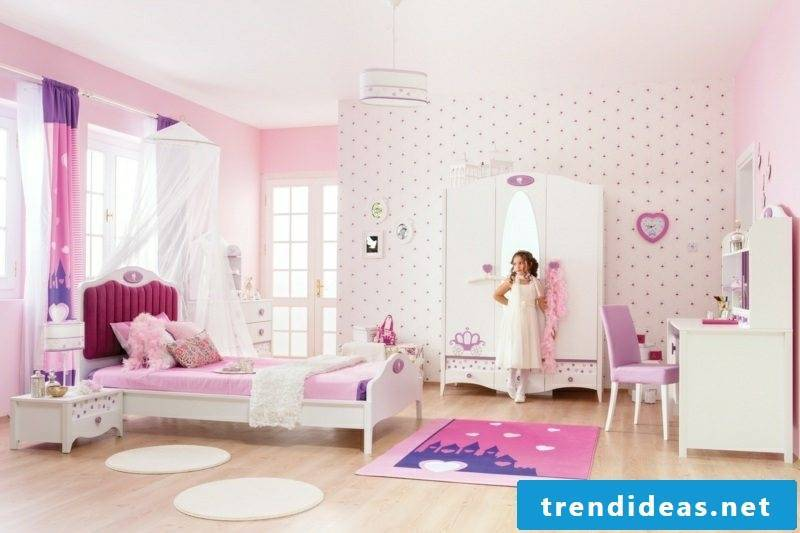 Girls room with growing cot