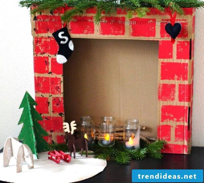 Decorative fireplace made of cardboard creates a cozy atmosphere