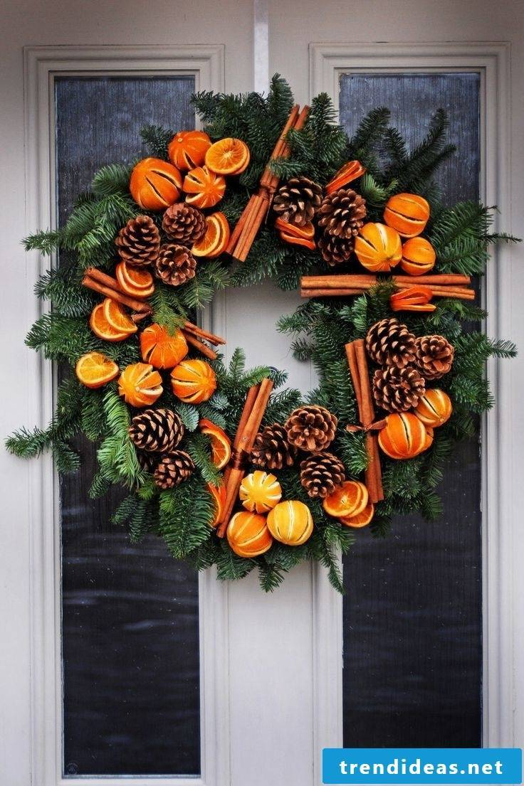 Christmas wreath with dry oranges and cinnamon sticks