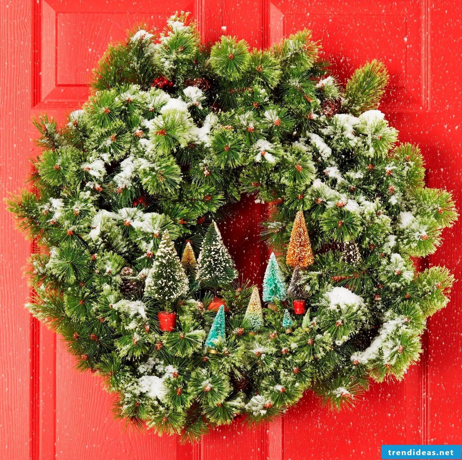 Beautiful door wreath with snow and fir trees
