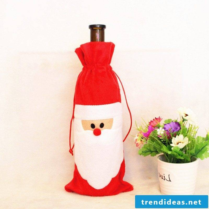 Nicholas present for friend Christmas liqueur wrapping Santa Claus