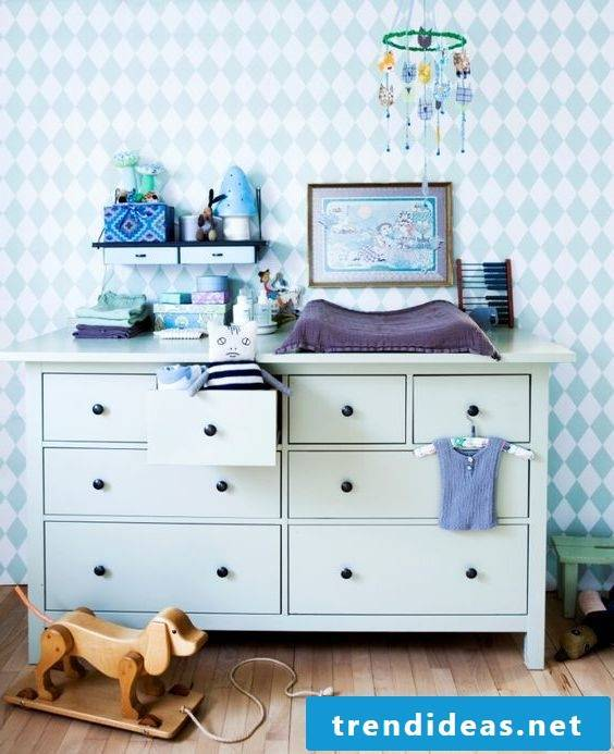 Changing table with matching baby room decoration