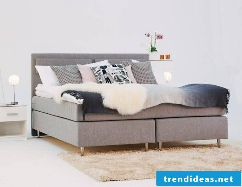 Box spring light gray upholstery decorative pillows