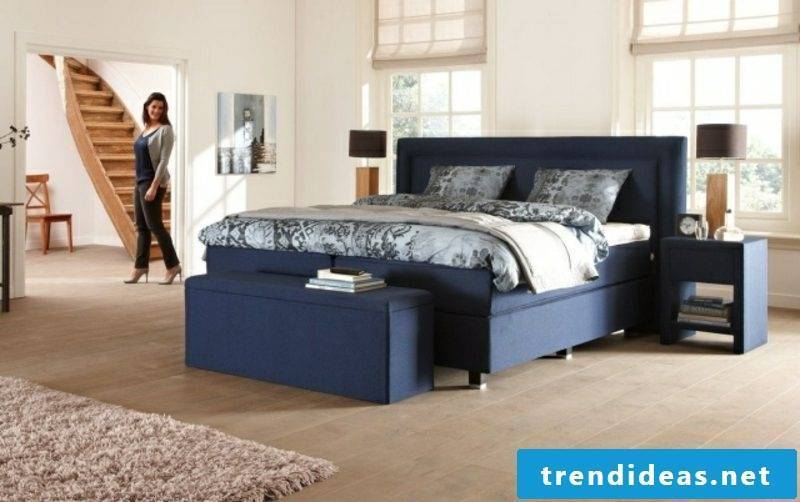 modern box spring bed with padding in navy blue