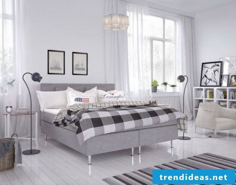 Boxspring bed with light gray fabric upholstery Scandinavian style