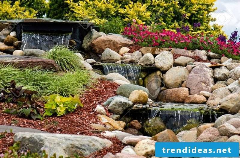 Create a stone bed to make a waterfall