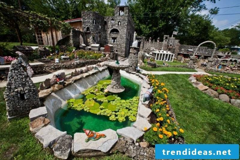 Create a stone bed to accentuate the garden pond