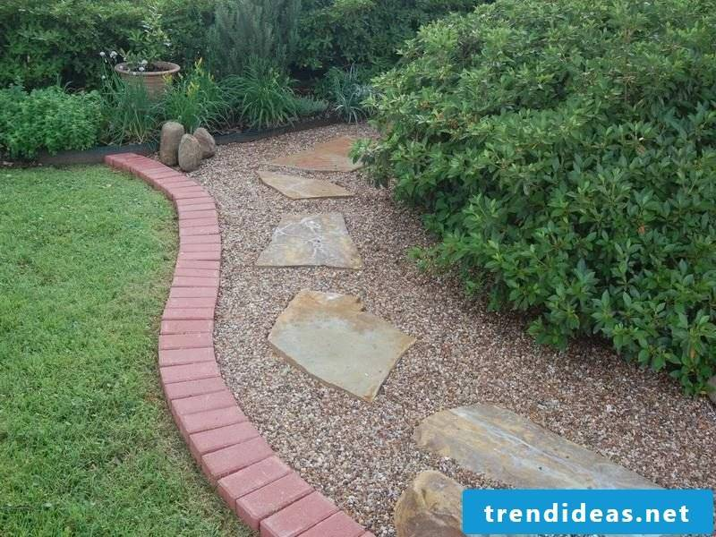 Create a bed of stone to create a separation from the grass
