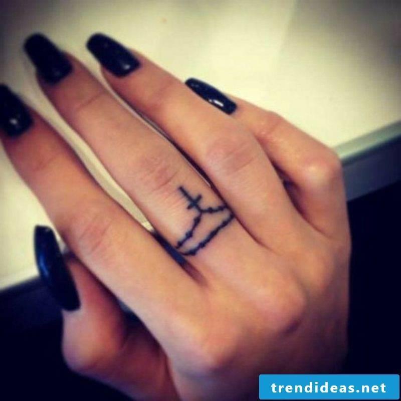 Cross tattoo as a ring original look