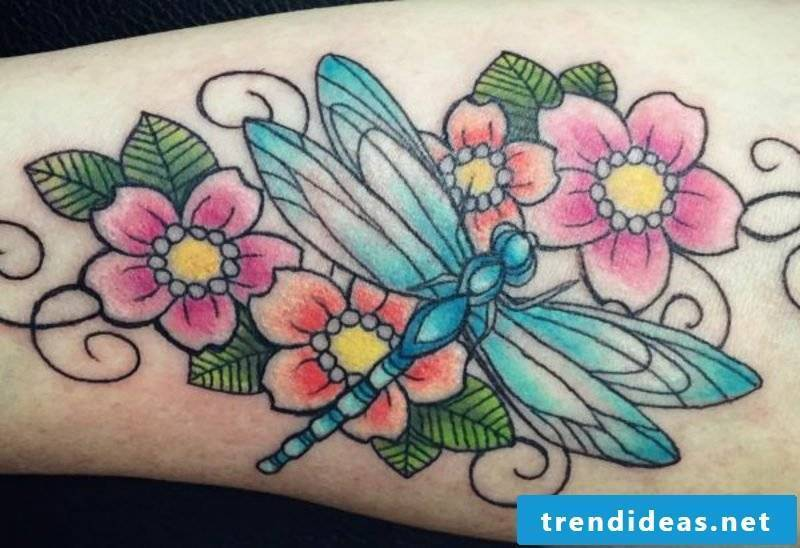 Tattoo dragonfly and flowers