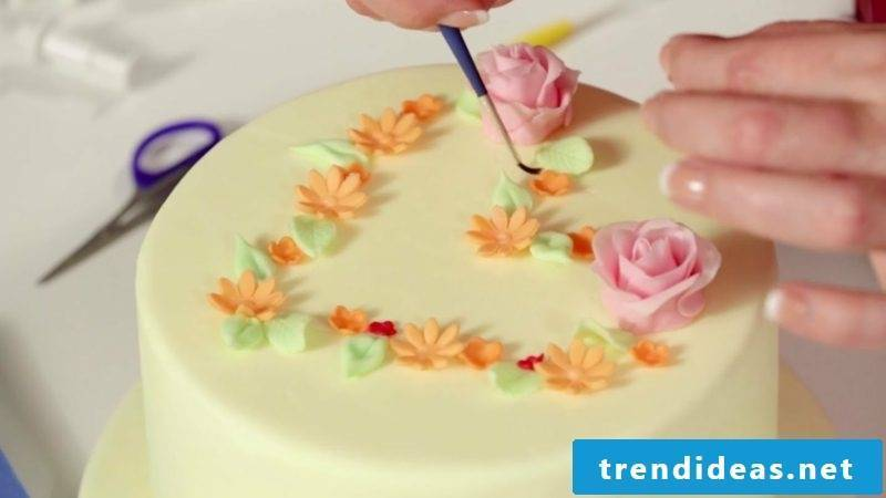 Pies decorate marzipan flowers