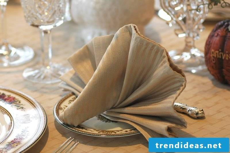 Decorate the table with such napkin shapes.