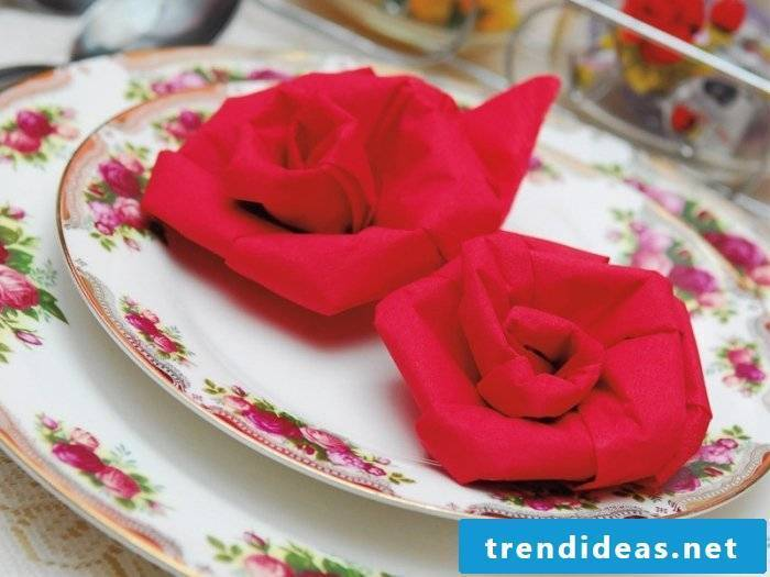 Make a rose from the napkins.