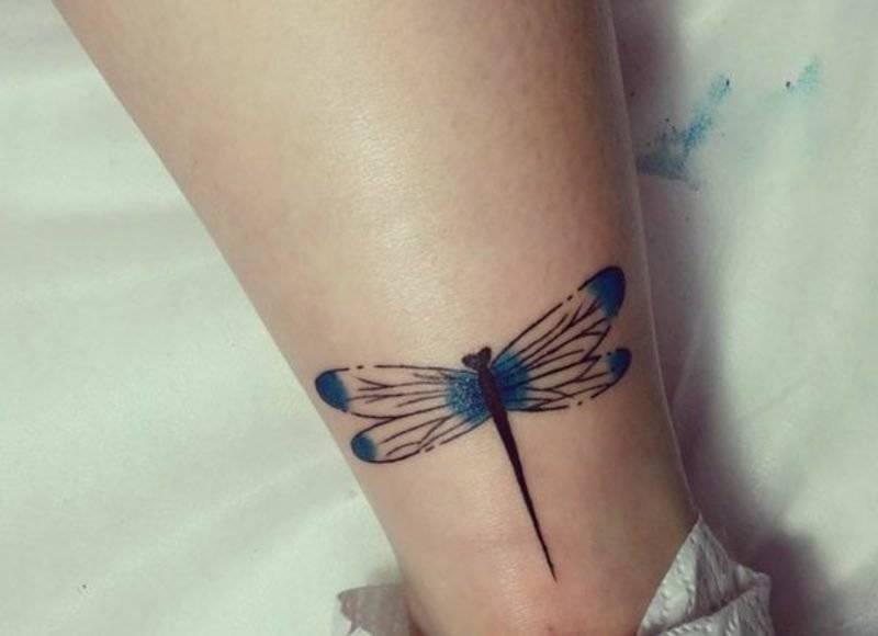 elegant dragonfly tattoo arm