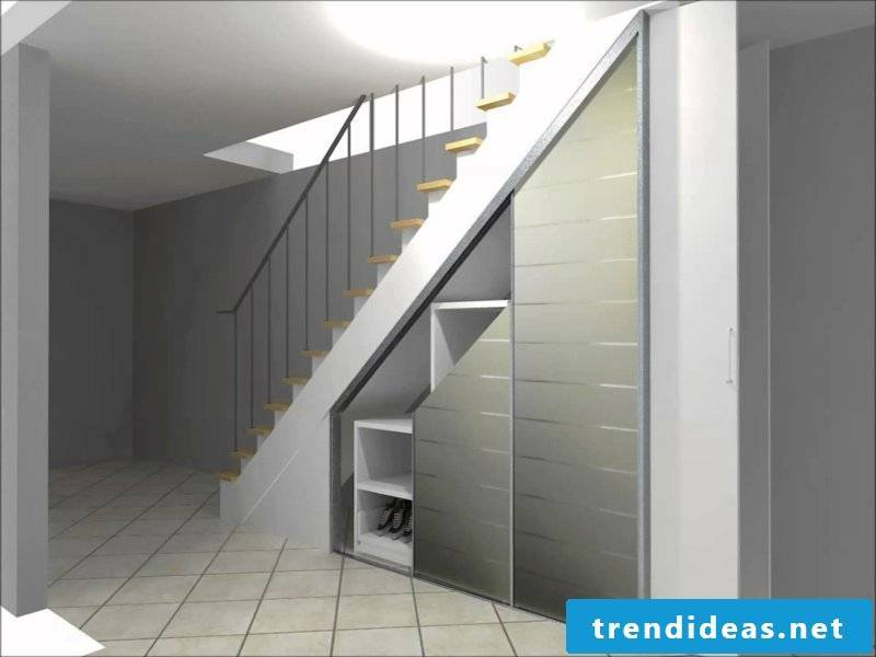 a minimalist wardrobe under the stairs