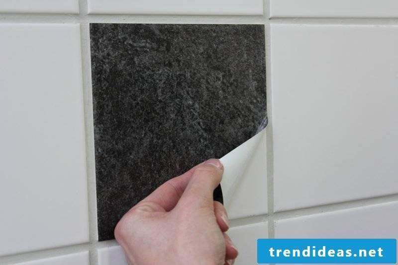 Glue wall tiles over bathroom