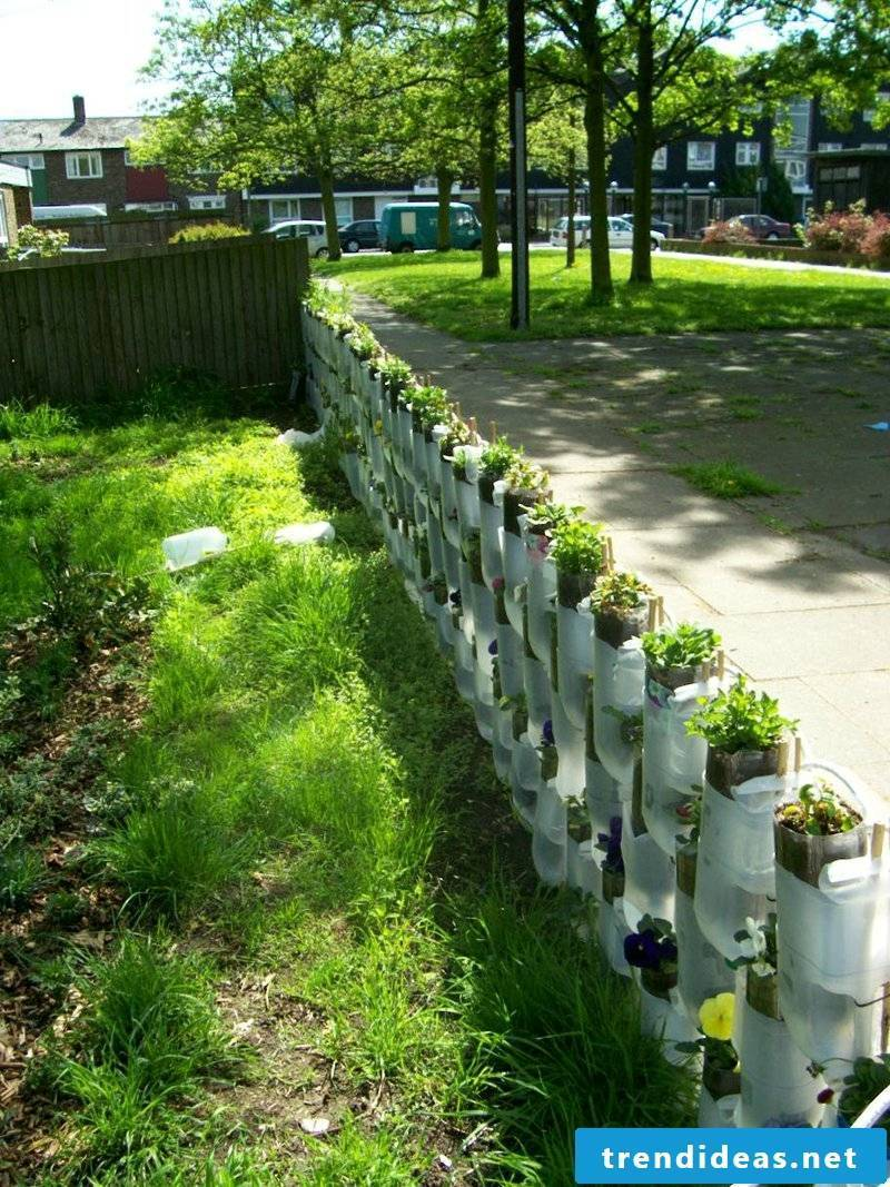 Empty bottles as flowerpots in the garden