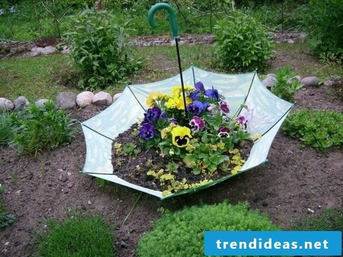 Umbrella in the garden as an eco-friendly garden decor