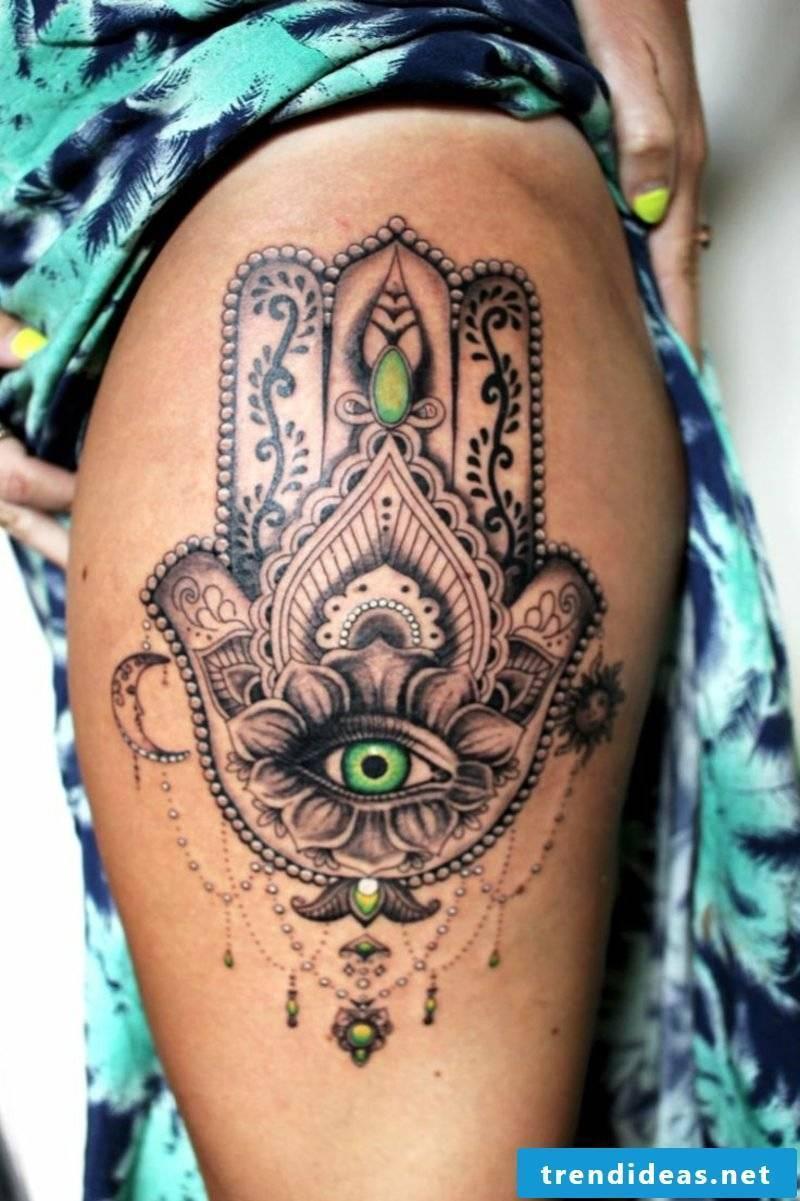 hamsa eyes tattoo thighs