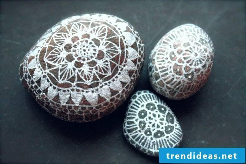 painted stones in white