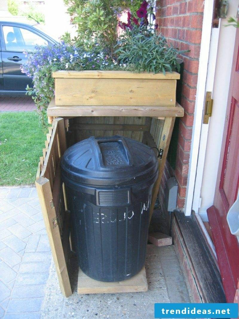 Dustbin cover wood roof planted