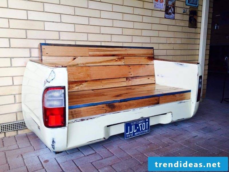 Creative idea for sofa made of europallets with car parts