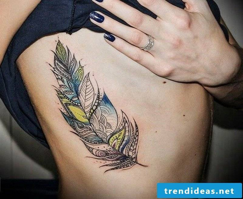 feather-tattoo-Interesting_colorful_tribal_feather_tattoo_on_rib-side