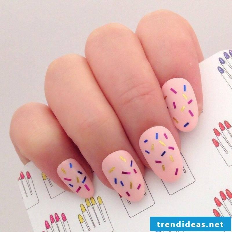 Fingernails design pink nail polish with decorative stripes