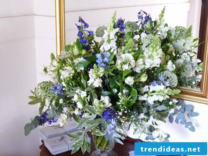 Floral arrangements for wedding blue and white