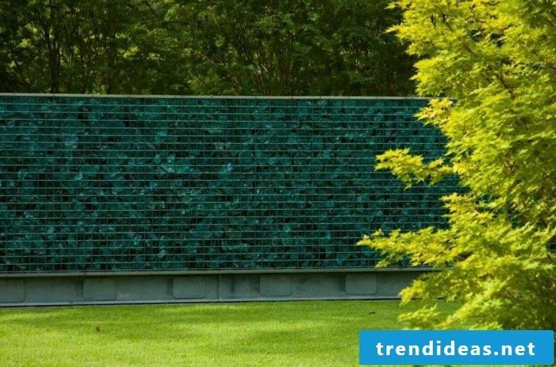 Gabion wall blue glass