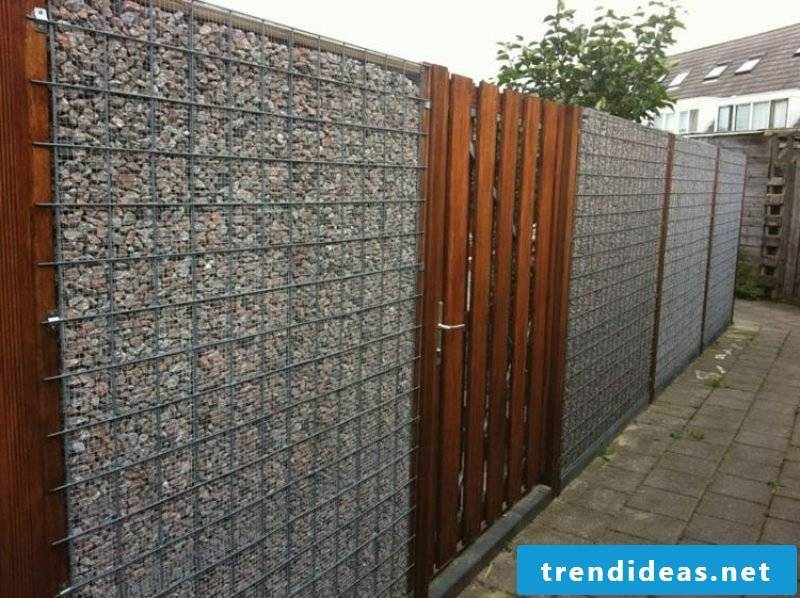 Contrast between wood and stone gabion fence