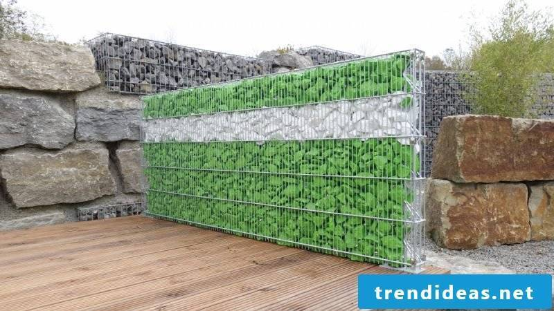 interesting gabion fence with colored stones