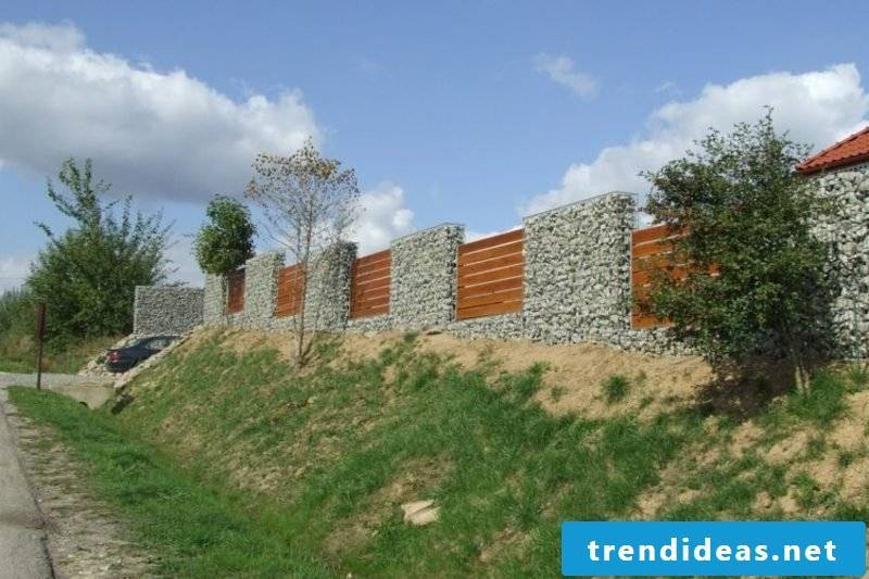 stone fence made of stone and wood