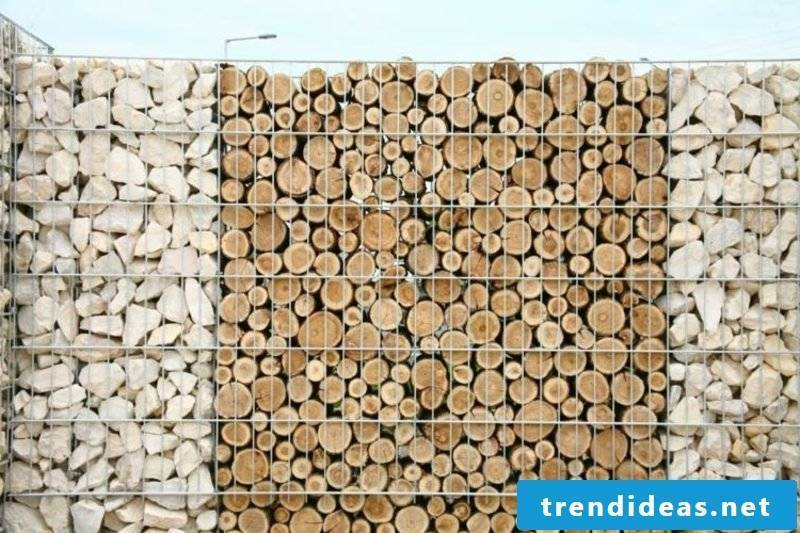 Gabion fence made of wood and stone