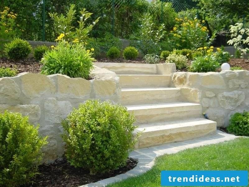 Garden design ideas stairs stone raised beds