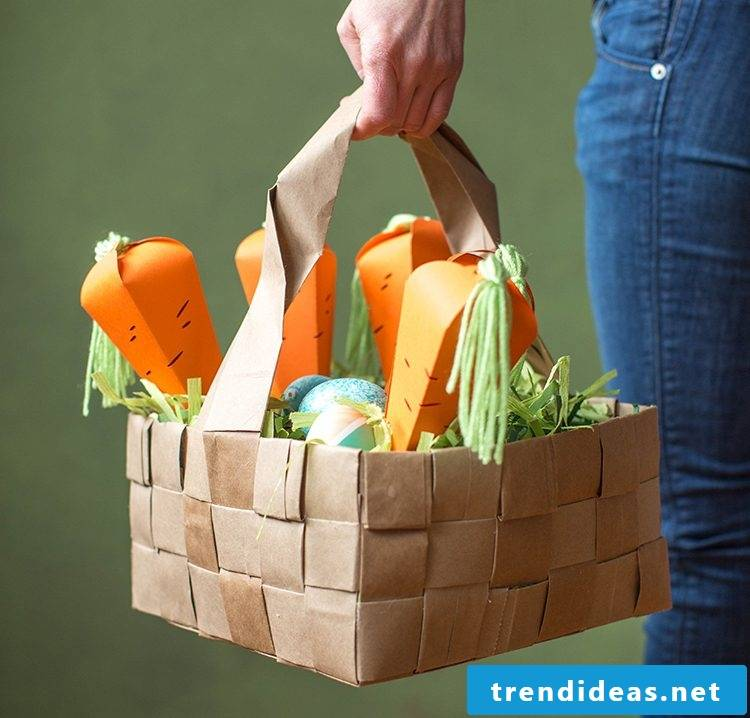 Easter handicrafts: Basket of carrots made of paper filled with puffed corn
