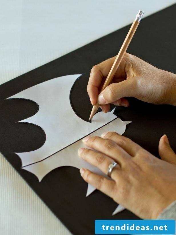 Put the craft templates on a black cardboard box