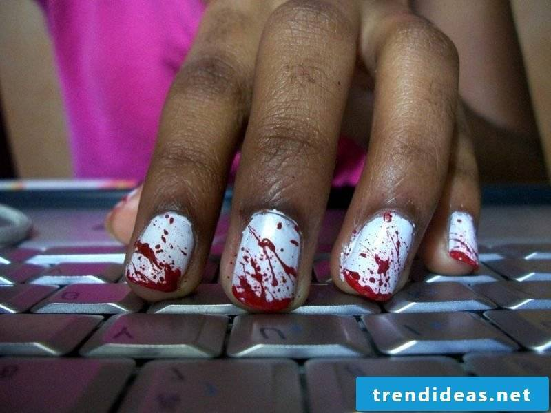 Red nail design for Halloween broken bloody nails