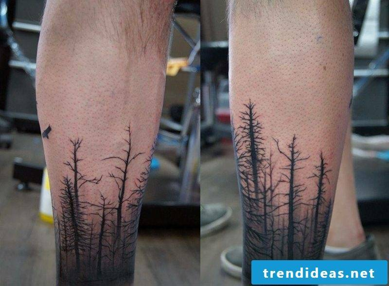 calf tattoo gray and black forest