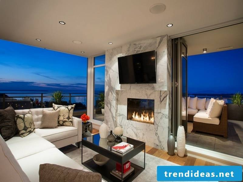modern fireplace and wall paneling with marble tiles