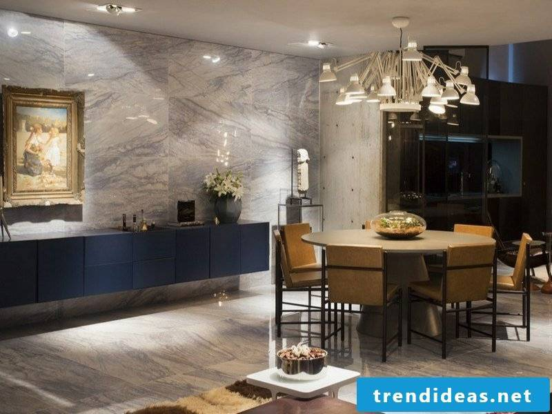 bluish wall design with marble tiles in the dining room