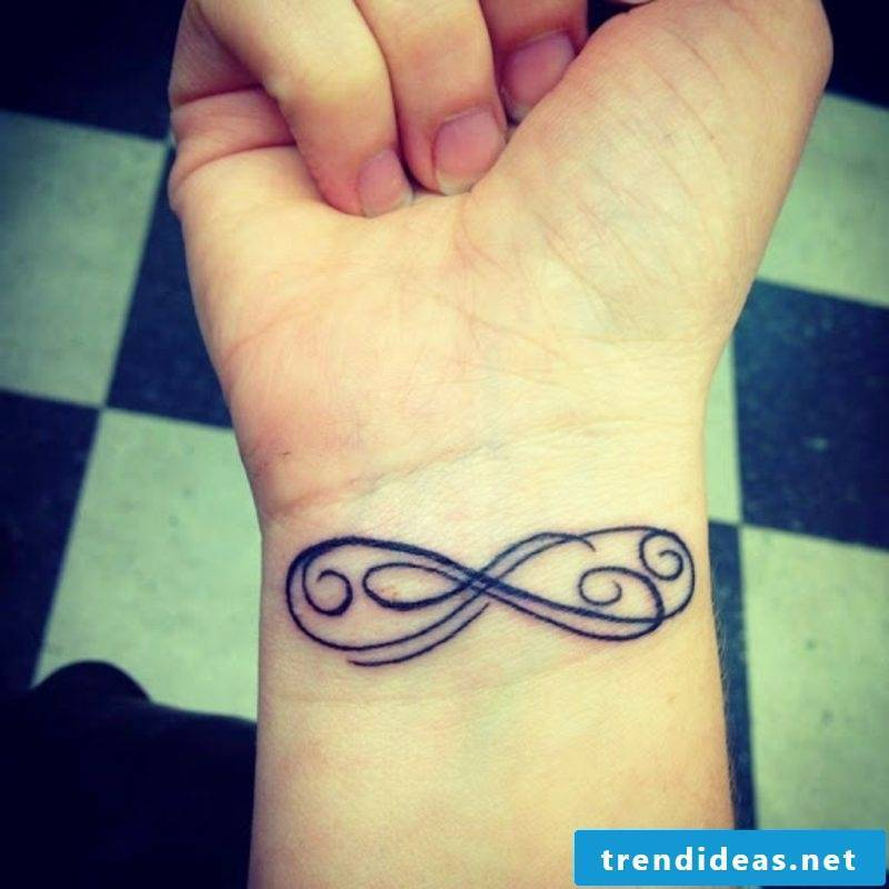 infinite sign tattoo on wrist