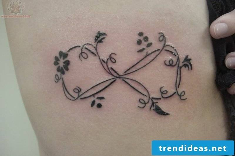infinity sign tattoo classic flowers